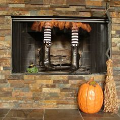 Though not technically a mantel, we had to include this cute DIY fireplace craft. Mother and daughter bloggers Jeanette and Leigh of Crafty in Crosby created this pair of witch legs out of old boots, a pool noodle, and Halloween tights.  See more at Crafty in Crosby.