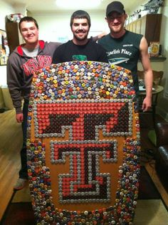 Awesome Texas Tech Double T Bottle Cap Coffee Table. I did help make this! How awesome :)