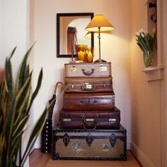 Stacked  http://dishfunctionaldesigns.blogspot.com/2012/01/creative-uses-for-vintage-suitcases.html