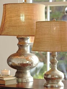 "These are upcycled old lamps with  ""looking glass"" krylon spray paint and burlap."