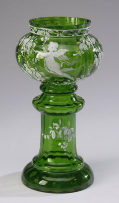 Bohemian green glass vase, hand decorated with a scene of a winged cherub among flowers.
