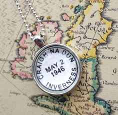 Outlander fan bling!  Vintage style postmark necklace of that fateful place and date:  Craigh na Dun, May 2, 1946.  by CrowBiz, $20.00  Also available as a keychain.