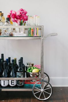 Bright and bold drink accessories go a long way on a silver cart.