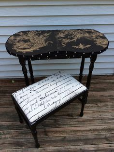 This sweet little vanity was updated with French inspired paper and black paint. The arms swing out with hooks underneath for necklaces or even a hair dryer.
