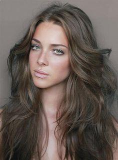 Medium ash brown natural hair color.