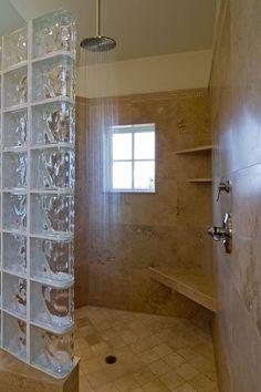 Master bathroom with rain shower and window.