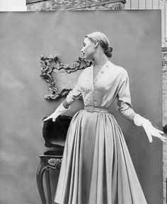 1951 Model in rayon satin dress with rhinestone buttons and full skirt by Martini for Diminutive, Vogue.