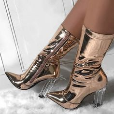 These amazing golden pointed toe chunky translucent bootie heels are destined to be your next best friend. Super hot deal.