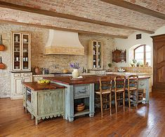 Tuscan kitchens often appear to have been put together over time, spanning decades or even generations. Re-create that lived-in look by choosing cabinets and furniture with different finishes, opting for different countertop materials and pairing mismatched chairs around an island or breakfast nook.