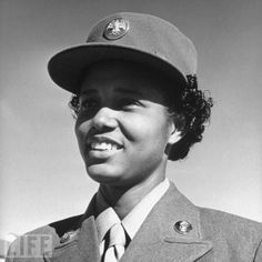 An Enlisted Member of America's Women's Air Corps (WACs) wearing her OD uniform with the matching hobby hat ~