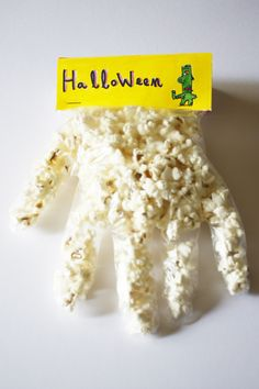 Hand of Halloween. My mom made these for my class every year in elementary school but she put a candy corn in the finger tip as the nail and a spider ring on the finger for an extra festive touch. #playeveryday