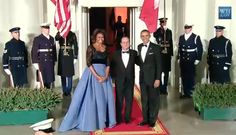 Last night First Lady Michelle Obama hosted French President Francois Hollande for a State Dinner, the first of President Obama's second term. For the occasion she chose a blue Carolina Herrera evening gown with a full skirt and black lace overlay top.