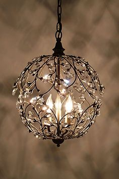 Crystal lights aren't just for dining rooms. This one is perfect for a powder room or entry. #let there be light