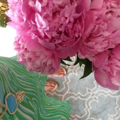Caitlin Hartley of Styled American green lilly pulitzer dress, blue kendra scott necklace, michael kors sandals holding pink peonies http://styledamerican.com/my-first-instagram-roundup/