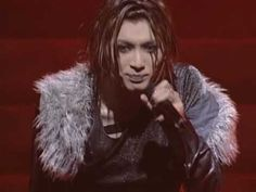 Brise by MALICE MIZER / Gackt <-- A combination of visual craziness but I love the song and Gackt's voice!