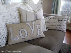 Pillow with button letters and appliqué