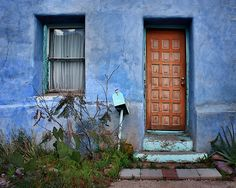 """""""Barrio Historico Door and Window"""" by Nikolyn McDonald Though the aqua paint on the door step and door and window trim of this blue Tucson home is worn, the Barrio Viejo house has lost none of its charm.  mailbox,adobe,tucson,barrio viejo,turquoise,charm,charming,southwest,southwestern,arizona,architecture,home,house,building,neighborhood,western,wall,entrance,old,viejo,cactus,colorful,door,window,barrio historico,aqua,blue,step,trim,worn,nikki,nikolyn,mcdonald"""