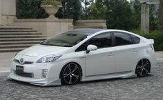 Toyota Prius with a body kit, lowering springs, & custom wheels. Weld Wheels, Truck Wheels, Wheels And Tires, Toyota Cars, Toyota Prius, Toyota Vehicles, Alloy Wheels For Sale, Toyota Hybrid, Slot Cars