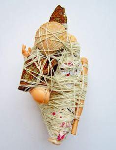 JUDITH SCOTT (1943-2005) | Visual artist isolated from outside influences as a result of the impact of deafness and Down's syndrome. She was independent and self-directed. Crafting armatures of bamboo slats and discarded materials, Judith diligently wrapped each work with lengths of knotted cloth or yarn. The artist was introduced to fiber art in 1987 by artist Sylvia Seventy at Creative Growth and produced a remarkable, breathtaking body of mixed media sculptures.