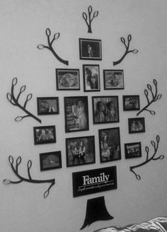 """Tree Wall Collage with Engagement pictures, wedding photos, honeymoon photos, maternity photos, and our children's photos.  I am all about designing on a dime so this is all Dollar Store frames, the """"Family"""" quote is from Walmart (about $4).  I cut the branches out of cardboard and made the leaves out of cut paper towel rolls, then just painted everything black. :)"""