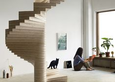 Risa spiral staircase by Tron Meyer features fanning timber steps.
