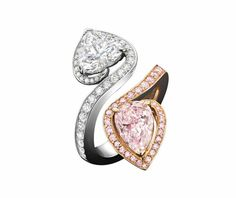 Boodles Gemini Heart ring set with a heart-shaped white diamond and oval-cut pink diamond in white and pink gold.