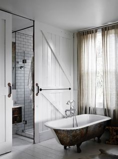 A white bathroom with salvaged claw foot bath tub  / Vintage House Daylesford. Photo Sharyn Cairns. Interior: Kali Cavanag.