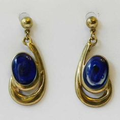 Fabulous and unique blue swirls drop earrings Oval enamel royal blue and white swirl in the middle with modernist frames in a gold tone Vintage