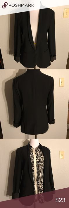 Express black tuxedo blazer Black tuxedo blazer. 100% polyester shell and lining. Looks cute open or closed (hook and eye). Pocket needs some love, see last image. No trades. Express Jackets & Coats Blazers