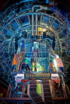 CERN Hadron Collider  The Large Hadron Collider (LHC) is a gigantic scientific instrument near Geneva, where it spans the border between Switzerland and France about 100m underground. It is a particle accelerator used by physicists to study the smallest known particles – the fundamental building blocks of all things. It will revolutionise our understanding, from the minuscule world deep within atoms to the vastness of the Universe.
