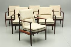 Arne Vodder rosewood conference armchairs produced by Sibast Furniture, Denmark.