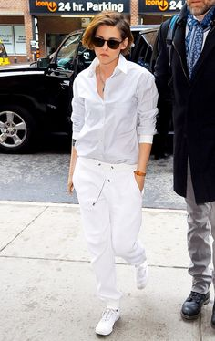 Kristen Stewart in a crisp button-up paired with white harem pants and a cool side-swept pixie