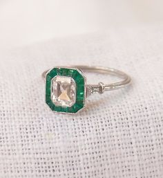 Art Deco Platinum .85 Carat Diamond and Emerald Engagement Ring by hotvintage on Etsy https://www.etsy.com/listing/220398421/art-deco-platinum-85-carat-diamond-and