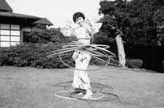 A young Japanese woman in a kimono takes part in the Hula-Hoop craze that swept America and Japan in this October 30, 1958, picture. (AP Photo/Mitsunori Chigita)