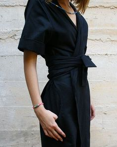 Black wrap dress. Find more at #ModellaStyle
