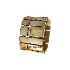 DKNY NY4380 WATCH - 674188180078-DKNY GOLD TONE PLASTIC CUFF LADIES WATCH - Bigapplewatch.com found on Polyvore
