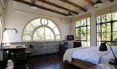 Master Bedroom With Half Arch Window With Circle Detail