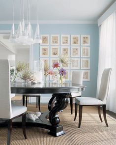 creamy blue wall with black table is gorgeous in this dining room