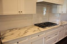 Vermont Danby marble top with white subway tile backsplash, and white cabinets.