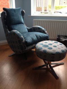 Swivel, rocking high back modern chair with matching footstool.  Interesting use of pattern and plain!