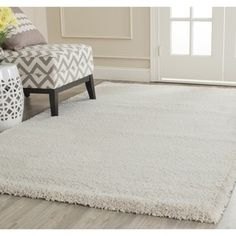 Shop for Safavieh Milan Shag Ivory Rug (10' x 14'). Get free shipping at Overstock.com - Your Online Home Decor Outlet Store! Get 5% in rewards with Club O!