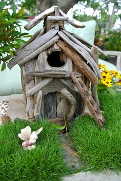 unique driftwood fairy house in a container landscape.