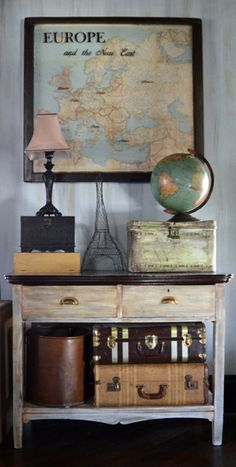Vintage 1943 map of Europe and the Near East, displayed beneath a vintage window sash with refinished frame (dark stain).  Accent painting on the glass.  From Second Chance Art & Accessories®.  $495
