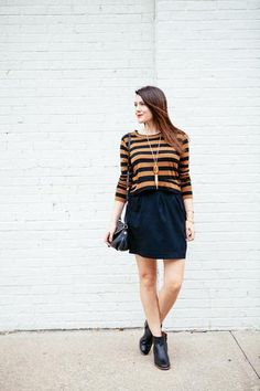 Stylish Fall Outfits to Build Around a Black Skirt | Photo: Kendi Everyday