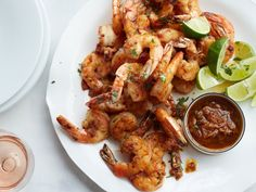Mexico City Shrimp with Chipotle Mojo. Chef Rick Bayless roasts garlic in oil, then spikes it with chipotle and lime so the sauce is tangy, spicy and smoky—terrific on sautéed shrimp. Shrimp Recipes, Fish Recipes, Mexican Food Recipes, Mexican Meals, Seafood Dishes, Fish And Seafood, Cooking Recipes, Healthy Recipes, Crockpot Recipes