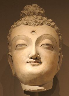 Head of a Buddha 4th cent., Gandhara Met Museum