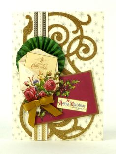 Handmade Christmas card from the Anna Griffin Holiday Trimmings Card Making Kit. This kit makes 60 unique cards with beautiful foil stamped metallic details, stunning dimensional embellishments, paper bows, ribbons and more! http://www.hsn.com/products/anna-griffin-holiday-trimmings-cardmaking-kit/7170195
