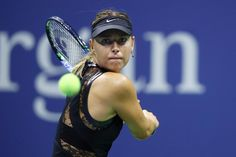 Maria Sharapova Photos - Maria Sharapova of Russia returns a shot during her first round Women's Singles match against Simona Halep of Romania on Day One of the 2017 US Open at the USTA Billie Jean King National Tennis Center on August 28, 2017 in the Flushing neighborhood of the Queens borough of New York City. - 2017 US Open Tennis Championships - Day 1