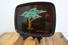 "Vintage 1966 Couroc (Monterey, California) ""Monterey Cypress"" resin tray with inlaid (wood and metal) tree design by S.F.B. Morse. $28 at BindersFullofVintage. https://www.etsy.com/listing/128617729/vintage-1960s-1966-couroc-monterey"