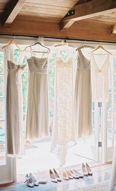 ** This would be nice outside hanging under the tree!! bridesmaids and bride dress hanging